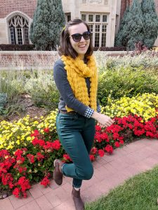 grey sweater, yellow scarf, green jeans