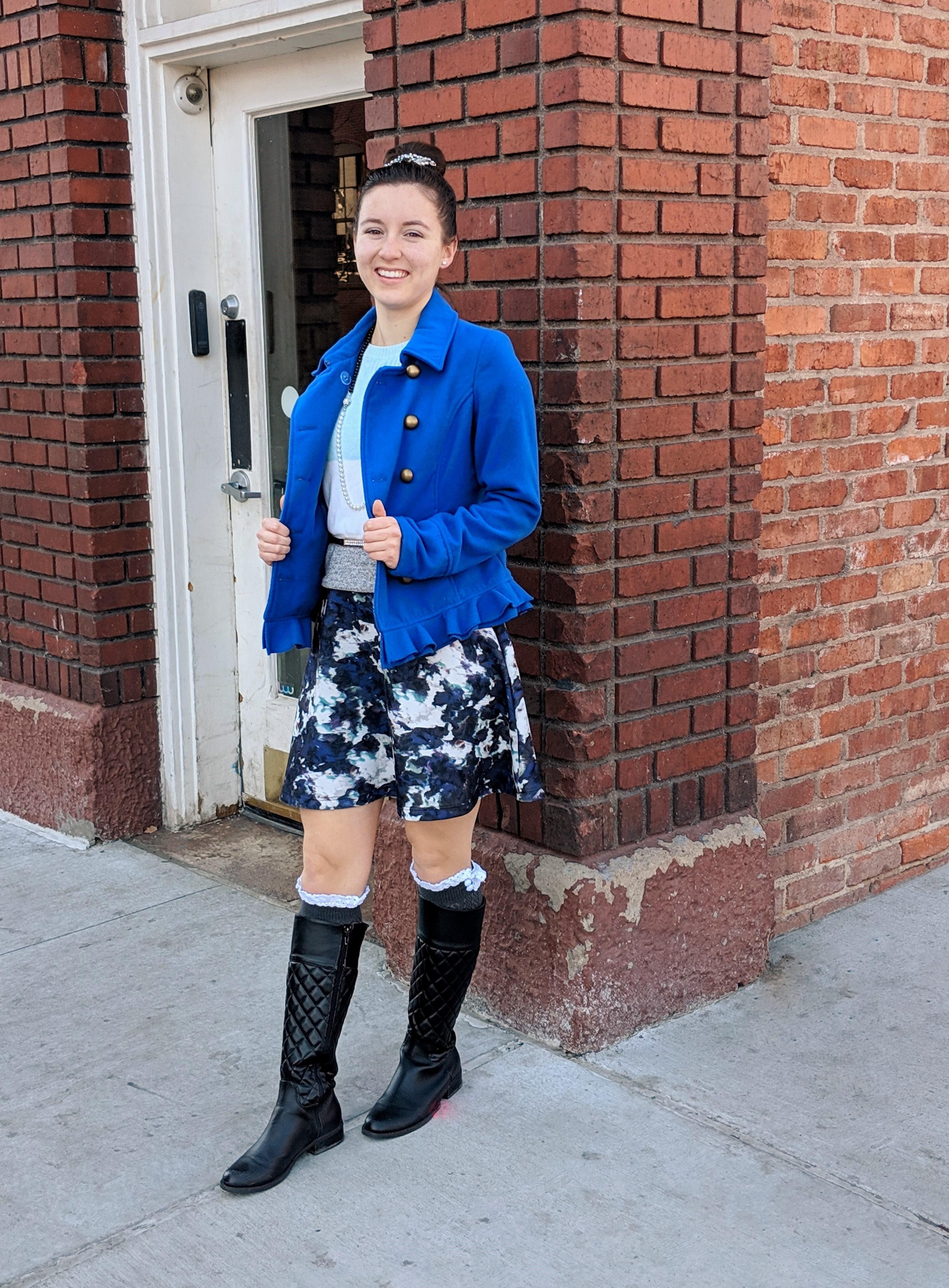 black boots blue coat patterned skirt