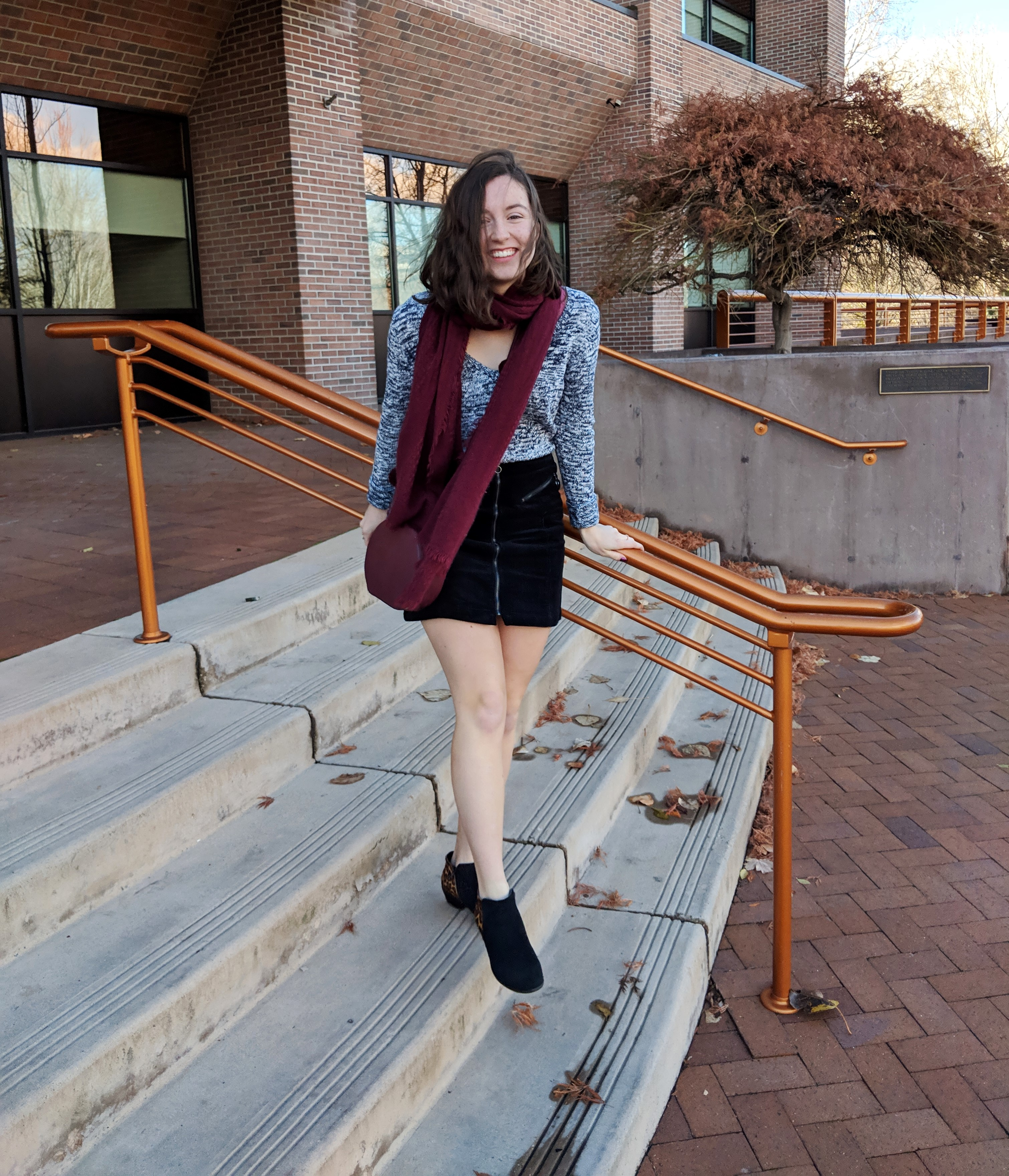 maroon accessories and heathered sweater