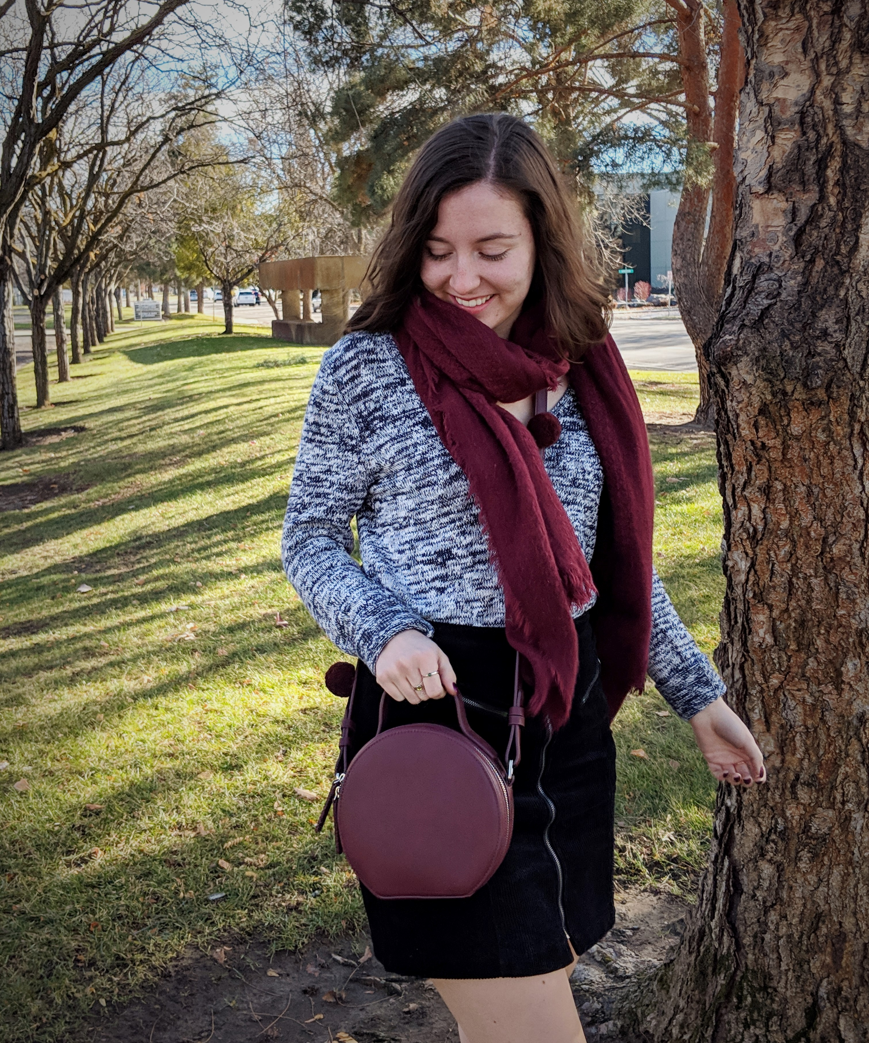 maroon trendy circle purse with pom poms