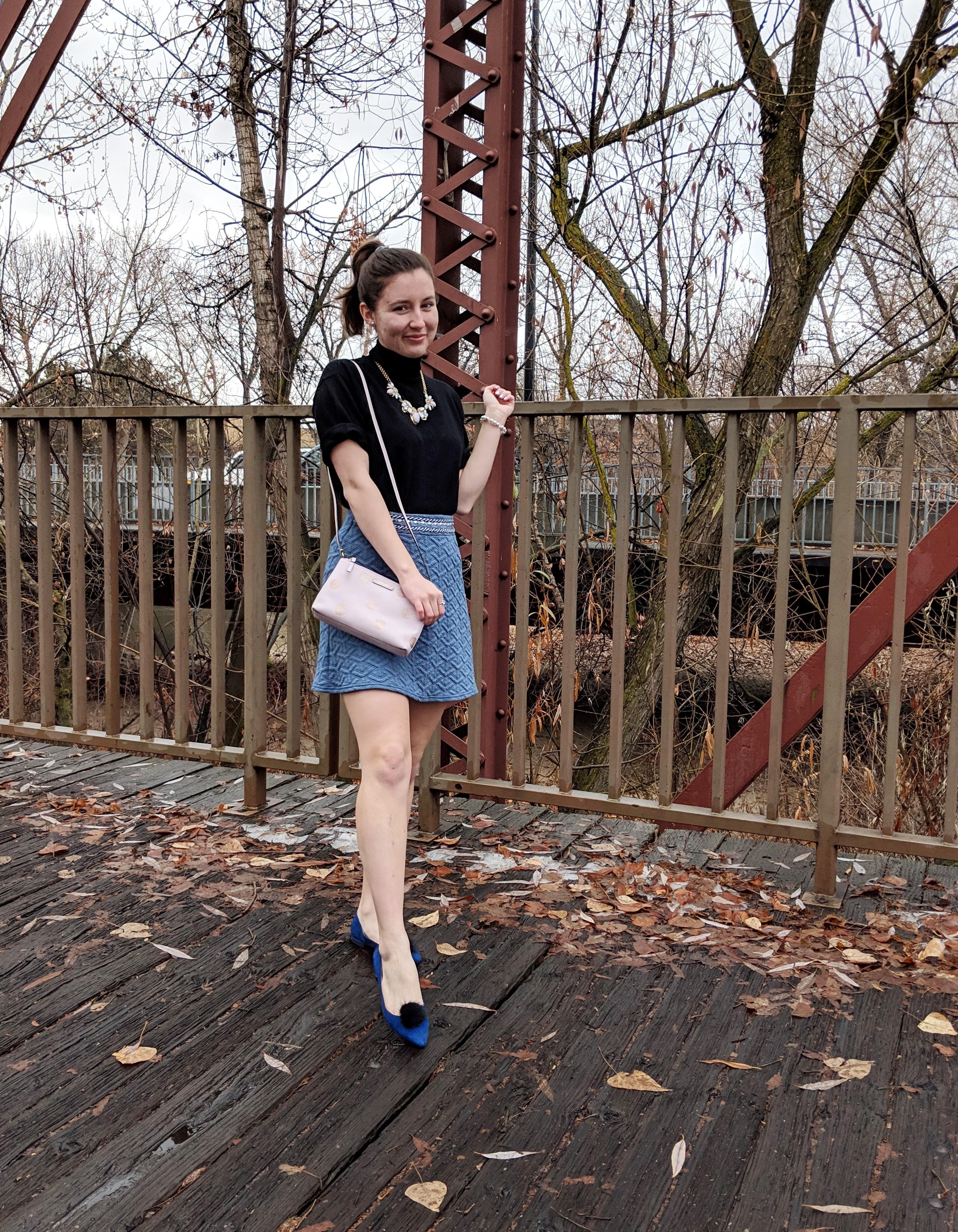 blue flats with black pom pom shoe clips