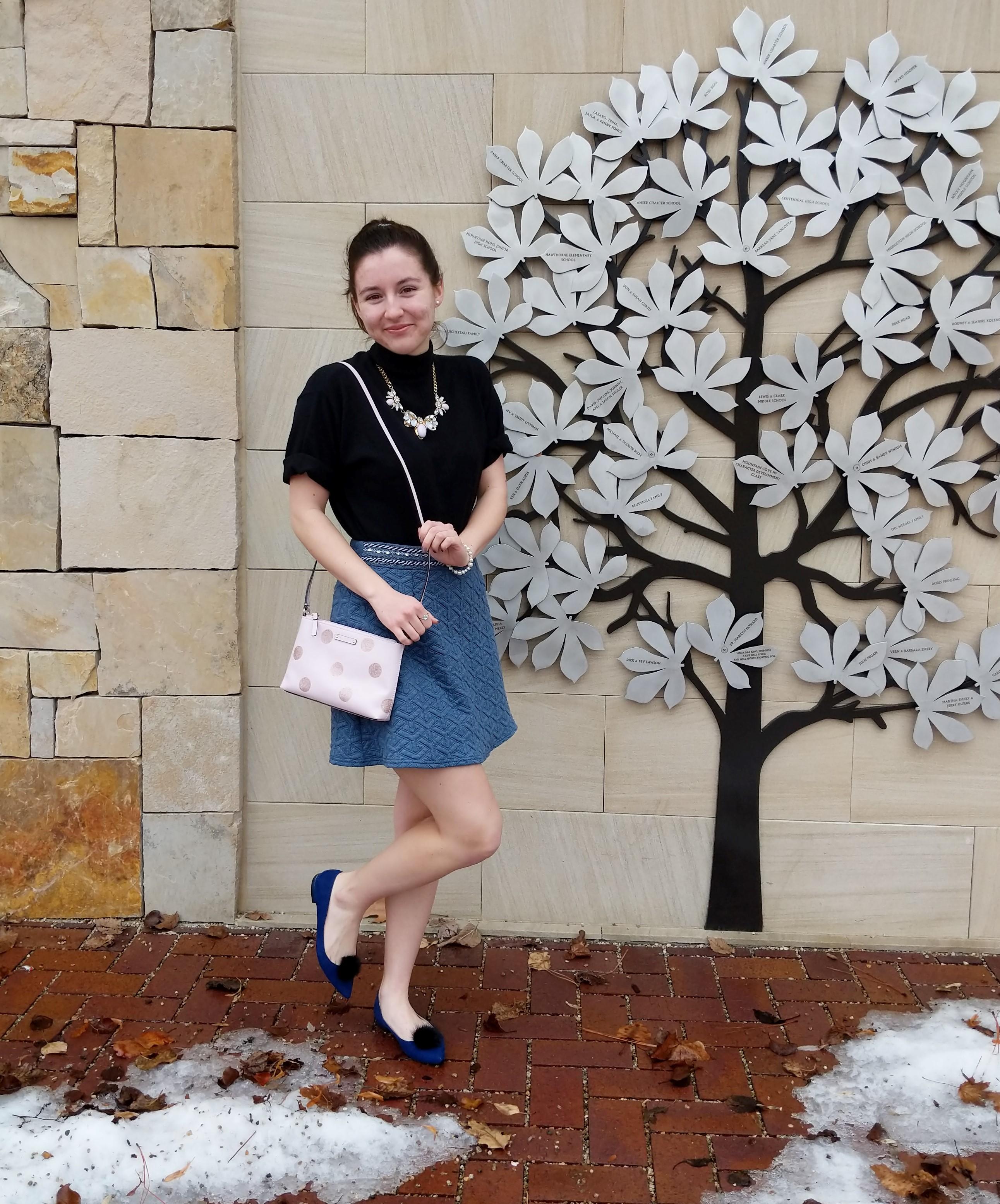 black turtle neck blue skirt