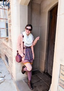 burgundy circle purse, patterned dress, coral sweater