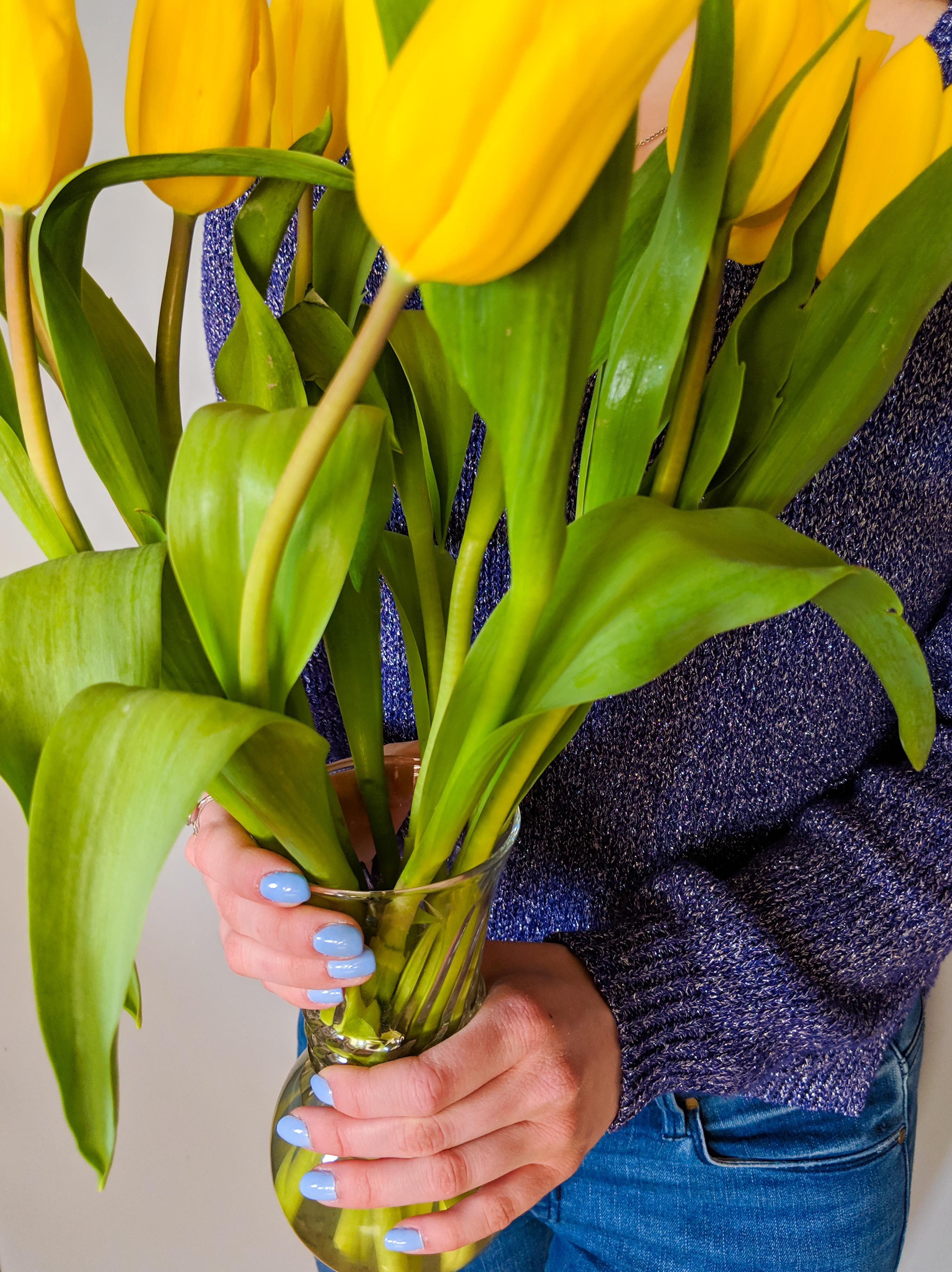 blue fingernails, yellow flowers, pastel nail polish