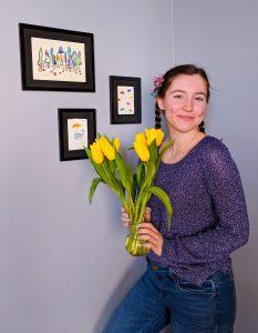 purple sweater, spring pastels, yellow tulips, blue fingernails