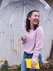 pink sweater, turquoise necklace, yellow purse, skinny jeans