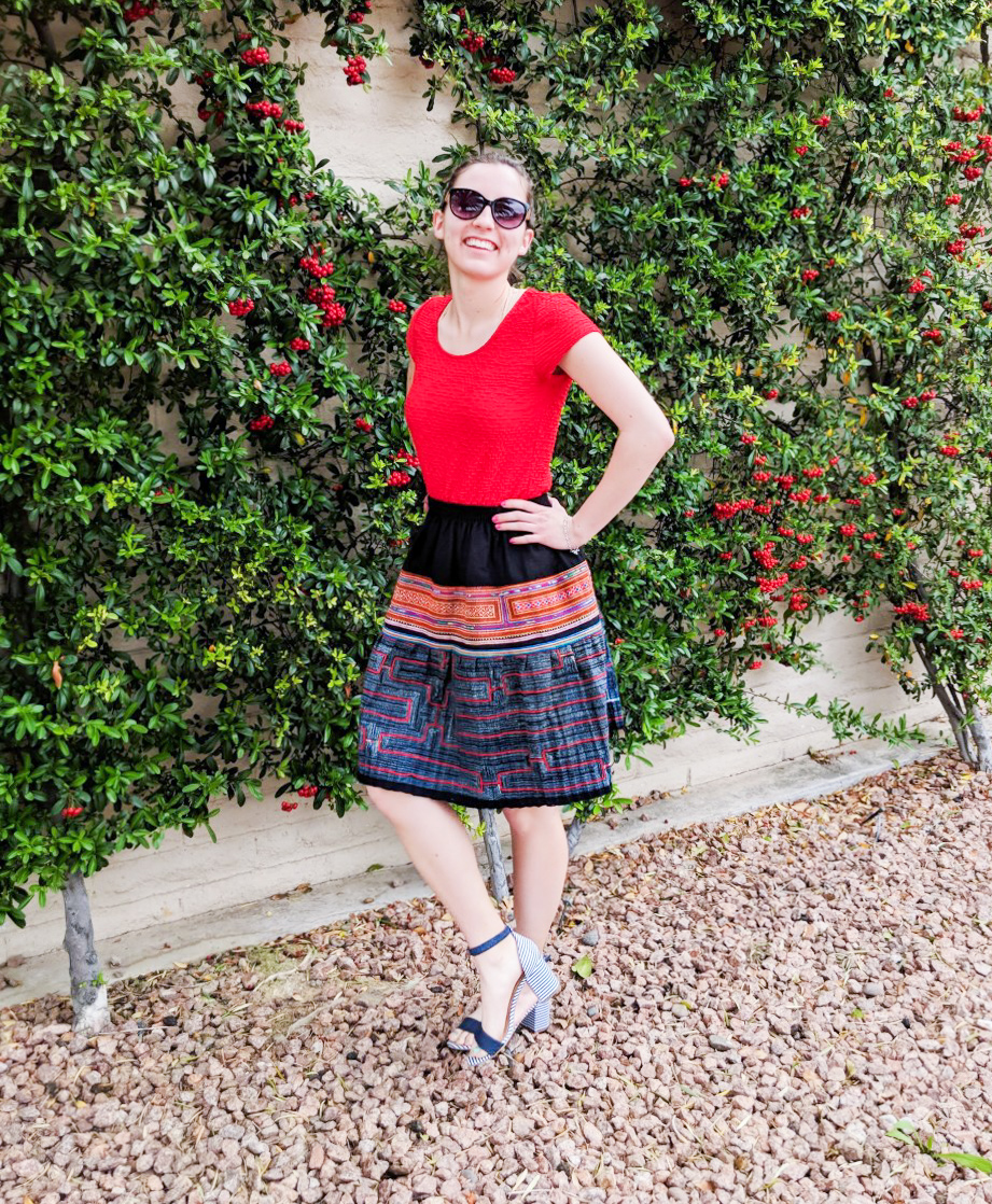 red shirt, patterned fair trade skirt, striped heels