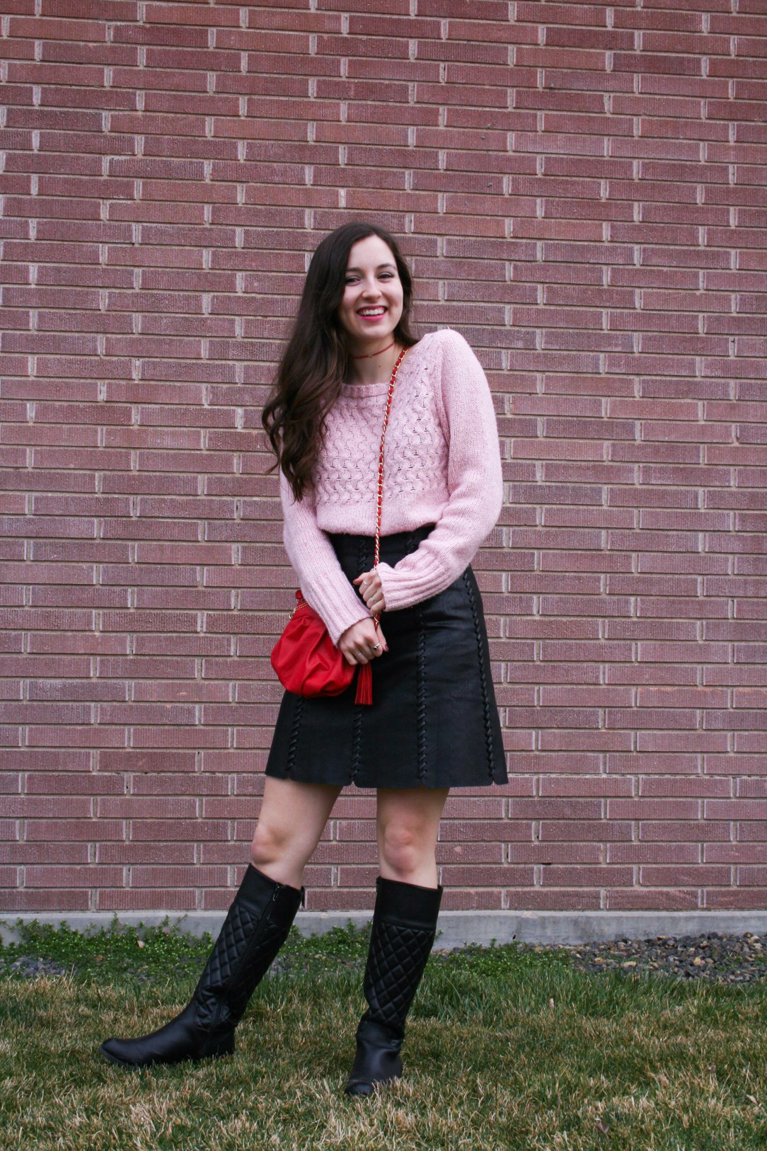 how to style pink, pink sweater, red purse, black pleather skirt, black boots