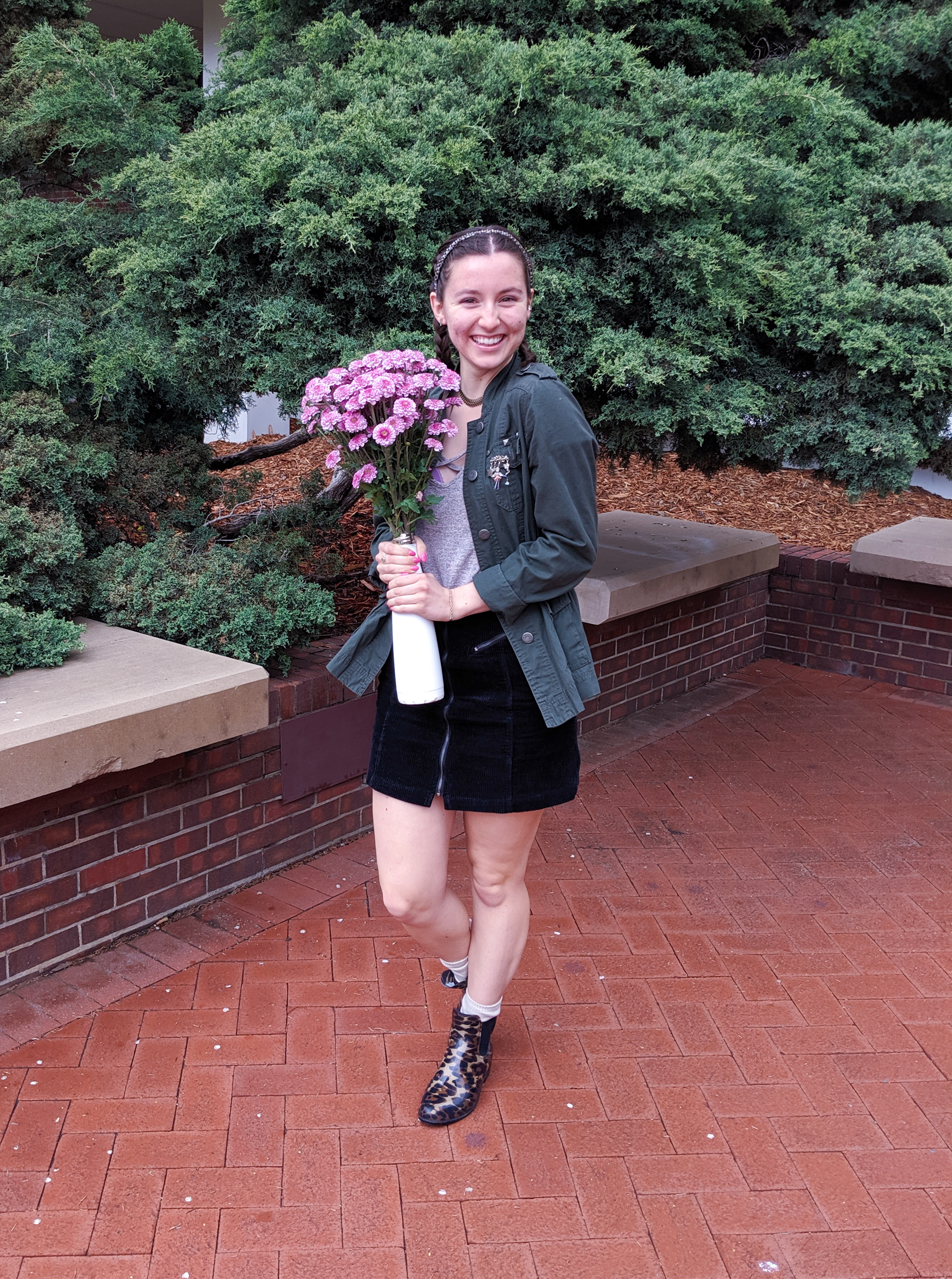 pink flowers, leopard rain boots, black mini skirt, blush shirt, green army jacket