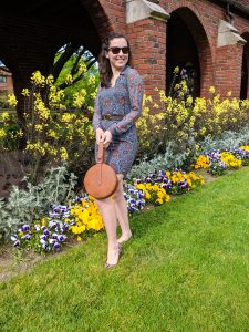 blue collared dress, brown circle bag