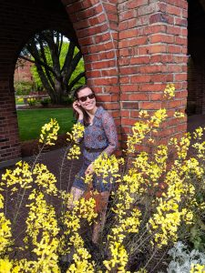 yellow flowers, blue patterned dress, University of Puget Sound