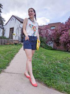 floral graphic tee, polka dot shorts, orange flats