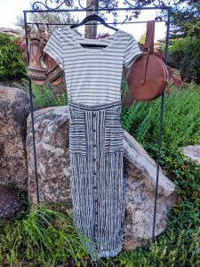 green striped top, striped maxi skirt, brown accessories