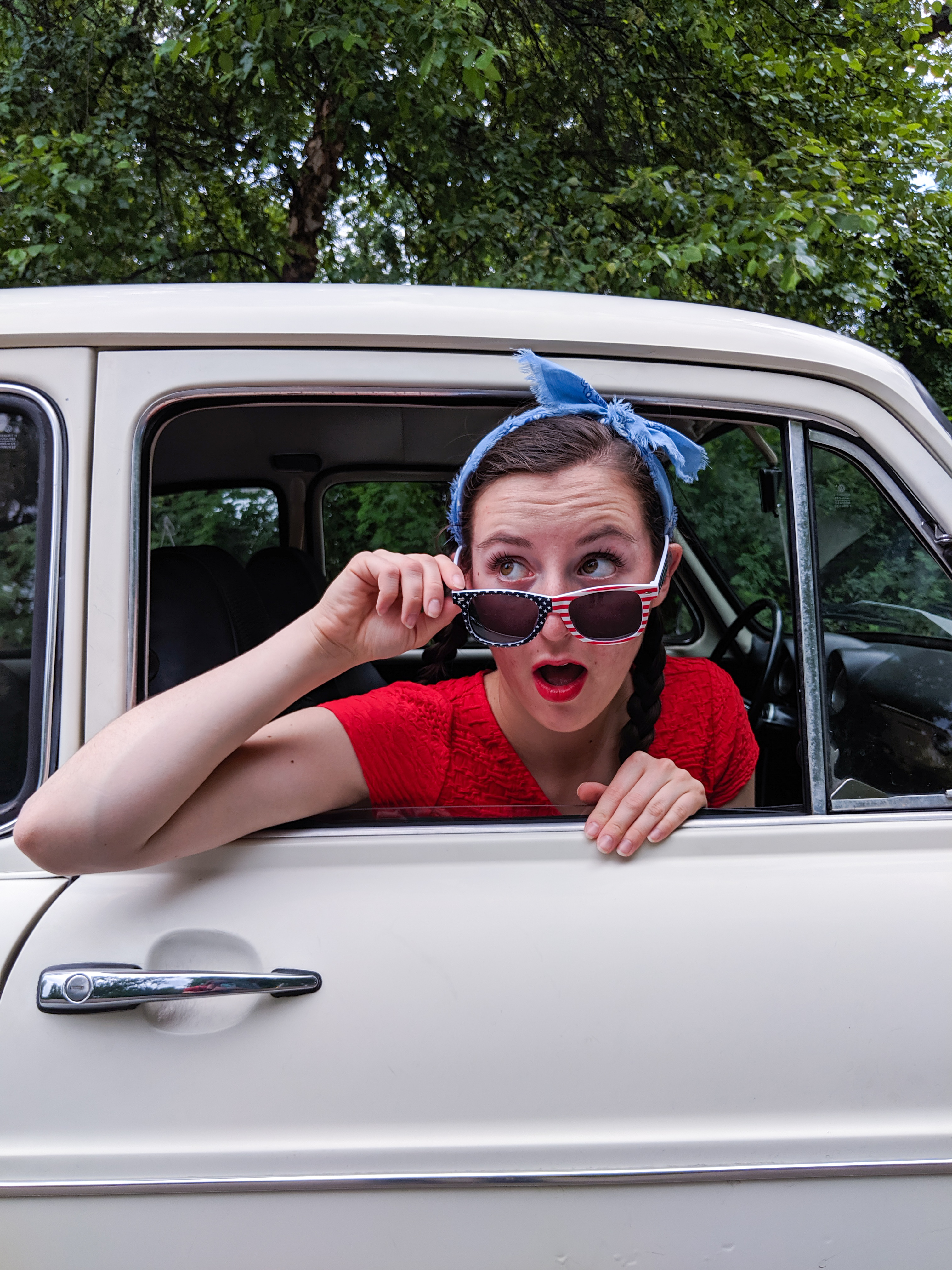 patriotic sunglasses, blue bandanna, old car, red lipstick