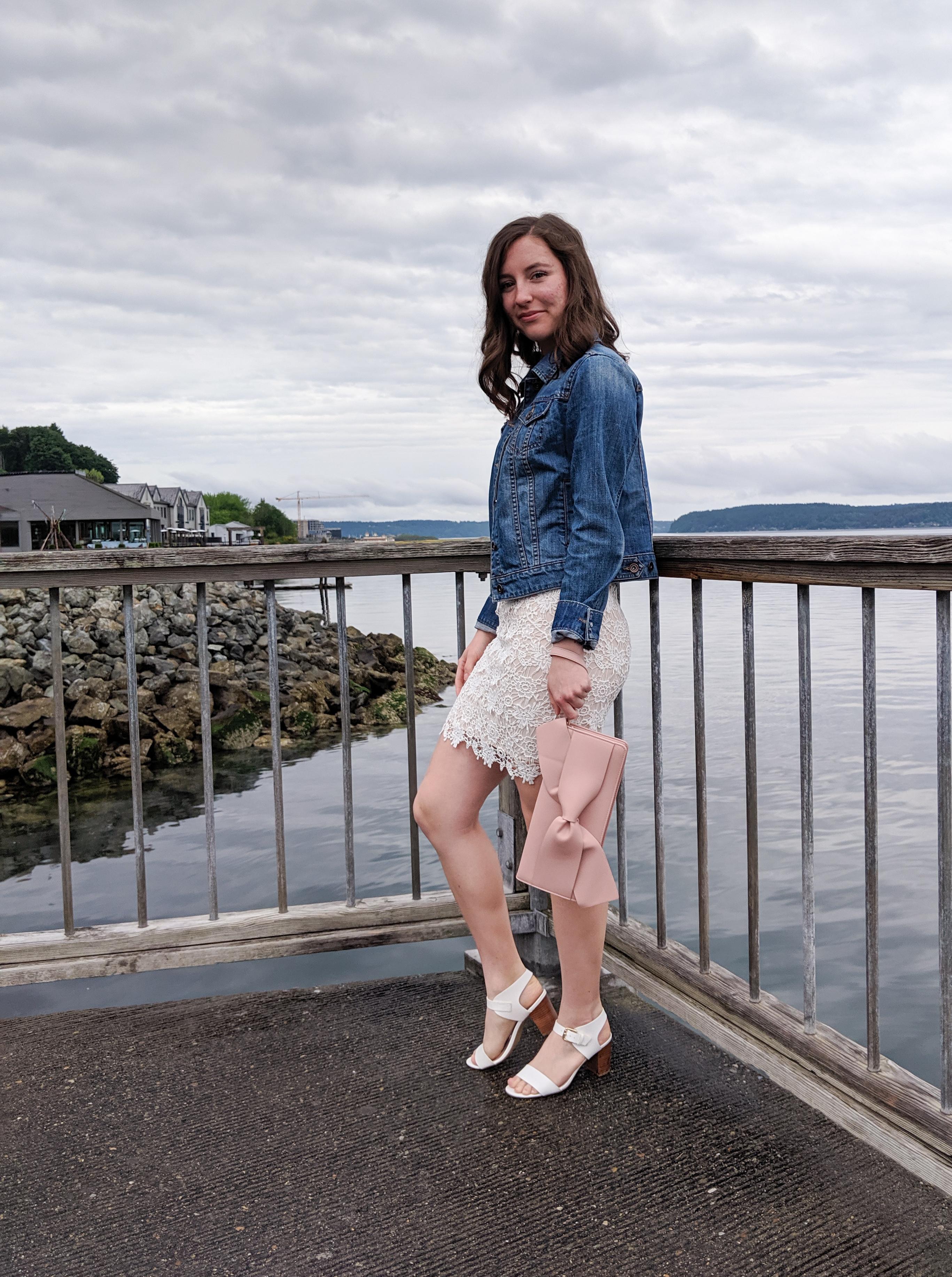 jean jacket, white lace dress, blush bow purse, white heels