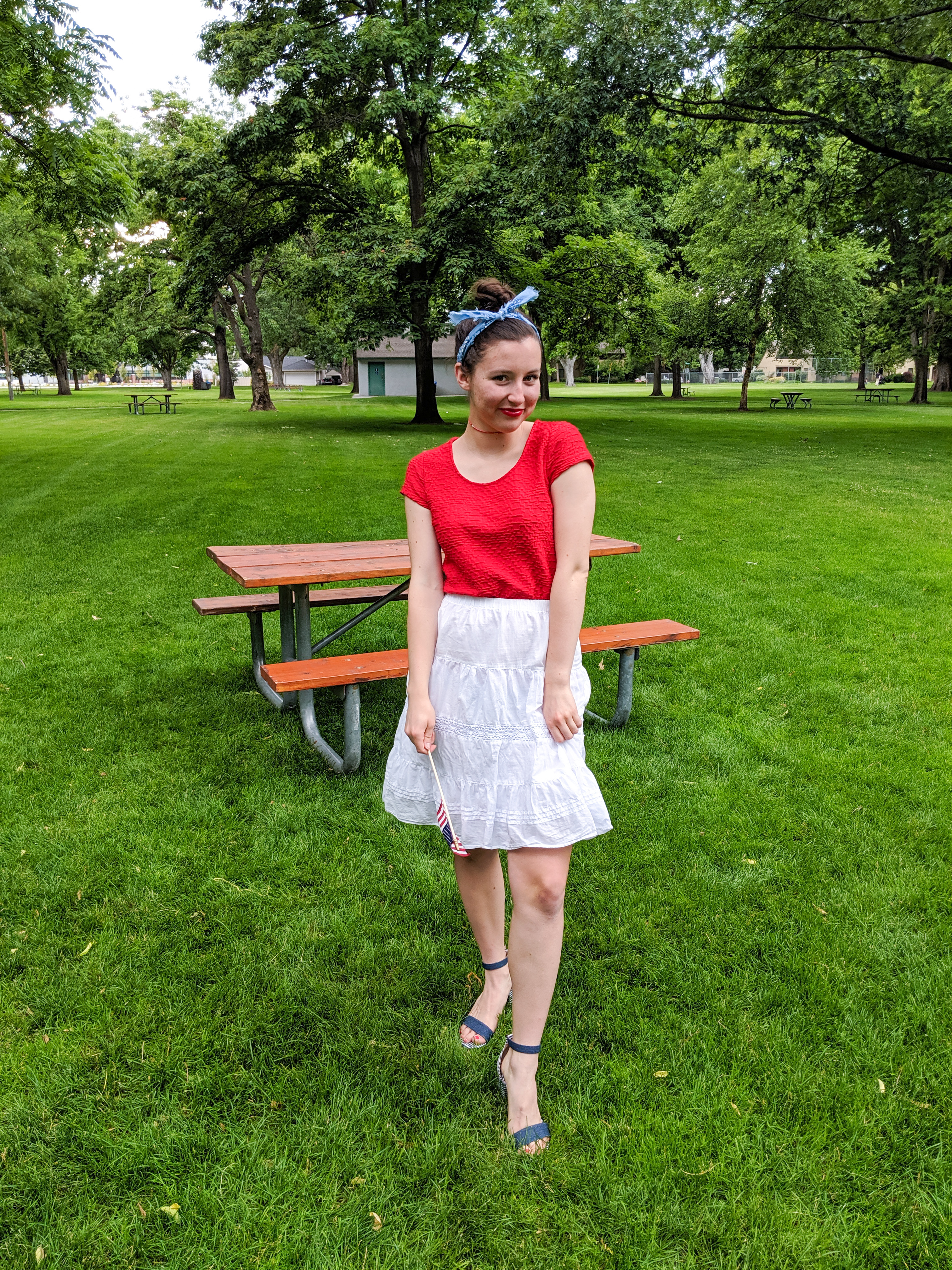 blue hair scarf, red shirt, white skirt, striped heels