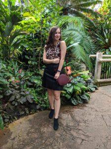 leopard dress, black leather skirt, burgundy purse, pom poms