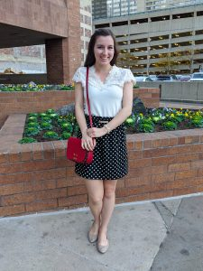 old fashioned blouse, polka dot skirt, red purse