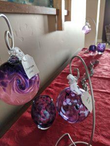 Christmas decorations, purple ornaments, candle votives