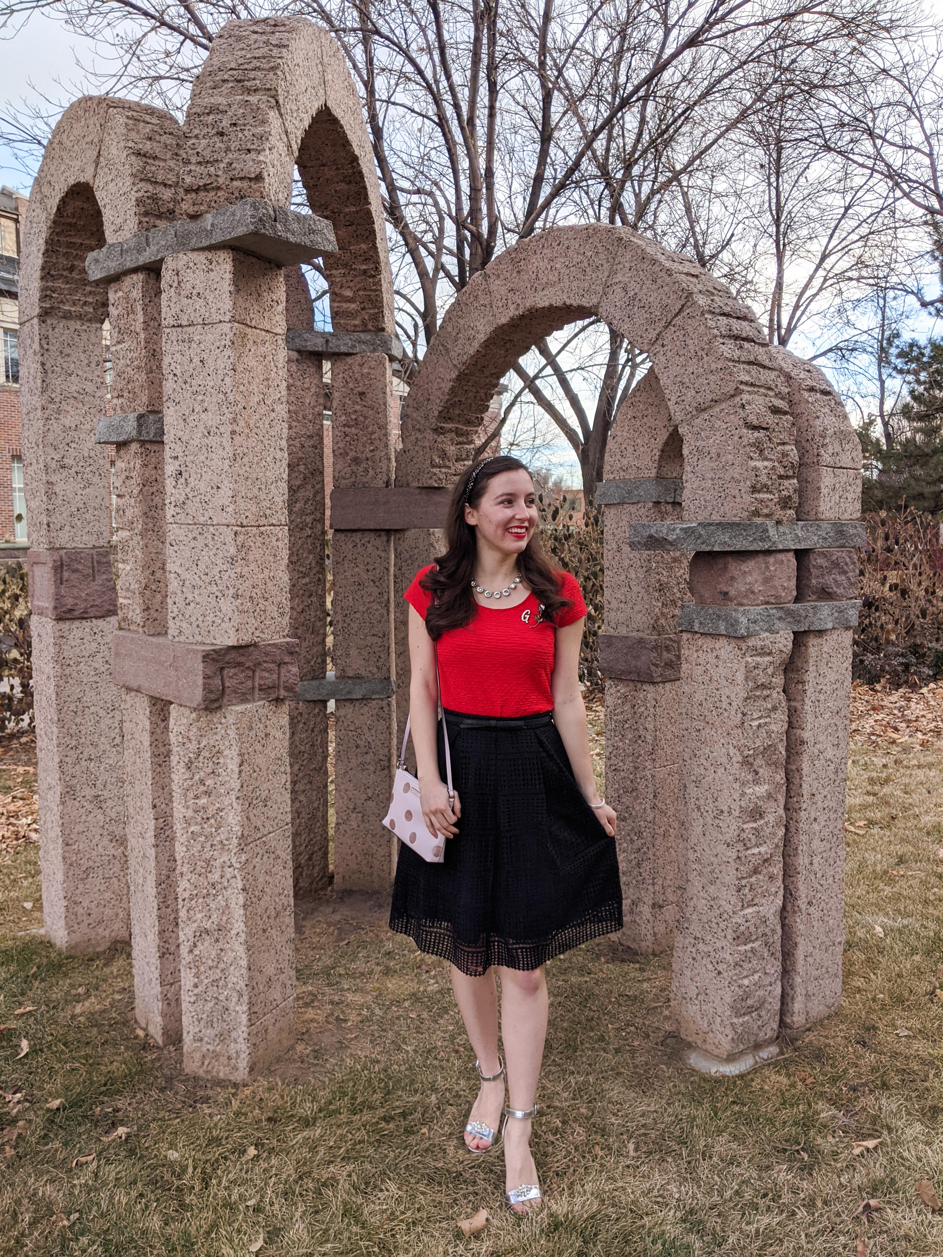 red blouse, black crochet skirt, silver heels, pink purse