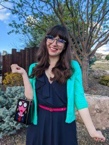 ruffle navy dress, green cardigan, pink belt, New Girl style