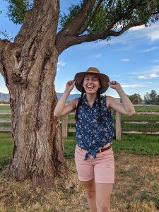 farming-cowgirl-blue-skies-camp-rainbow-gold