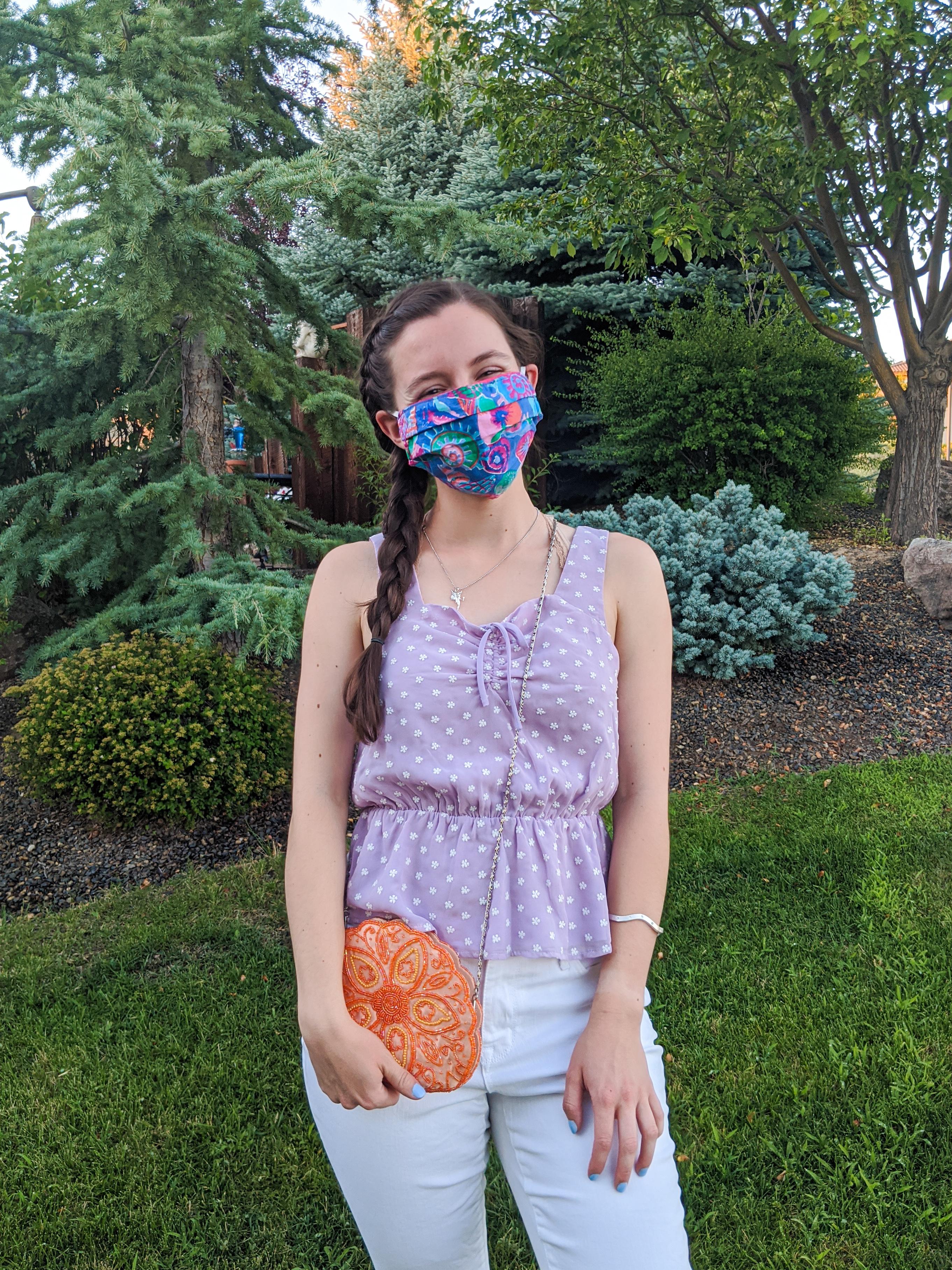 lavender-top-orange-purse-colorful-face-mask