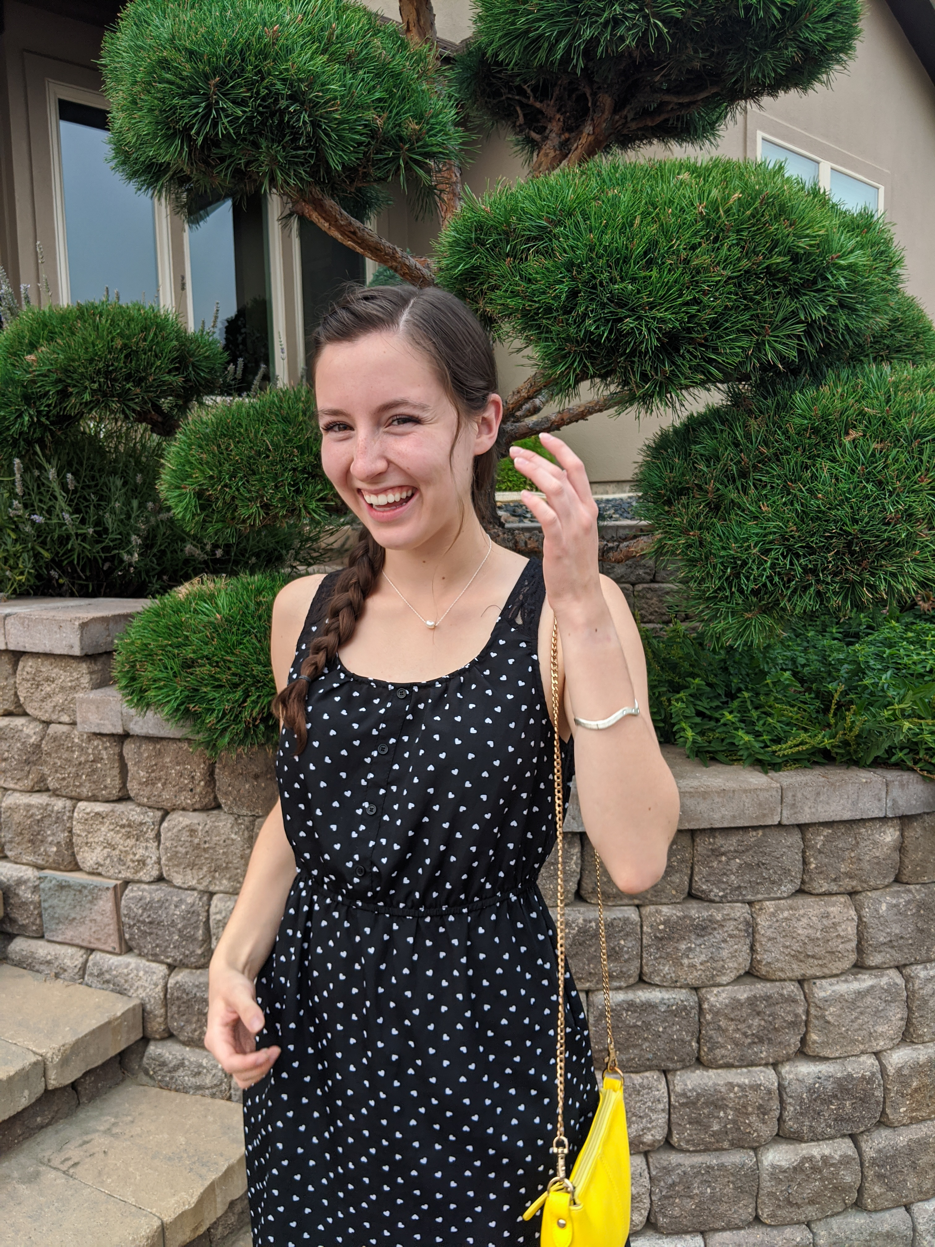 dotted-dress-yellow-purse-pearl-necklace-side-braid