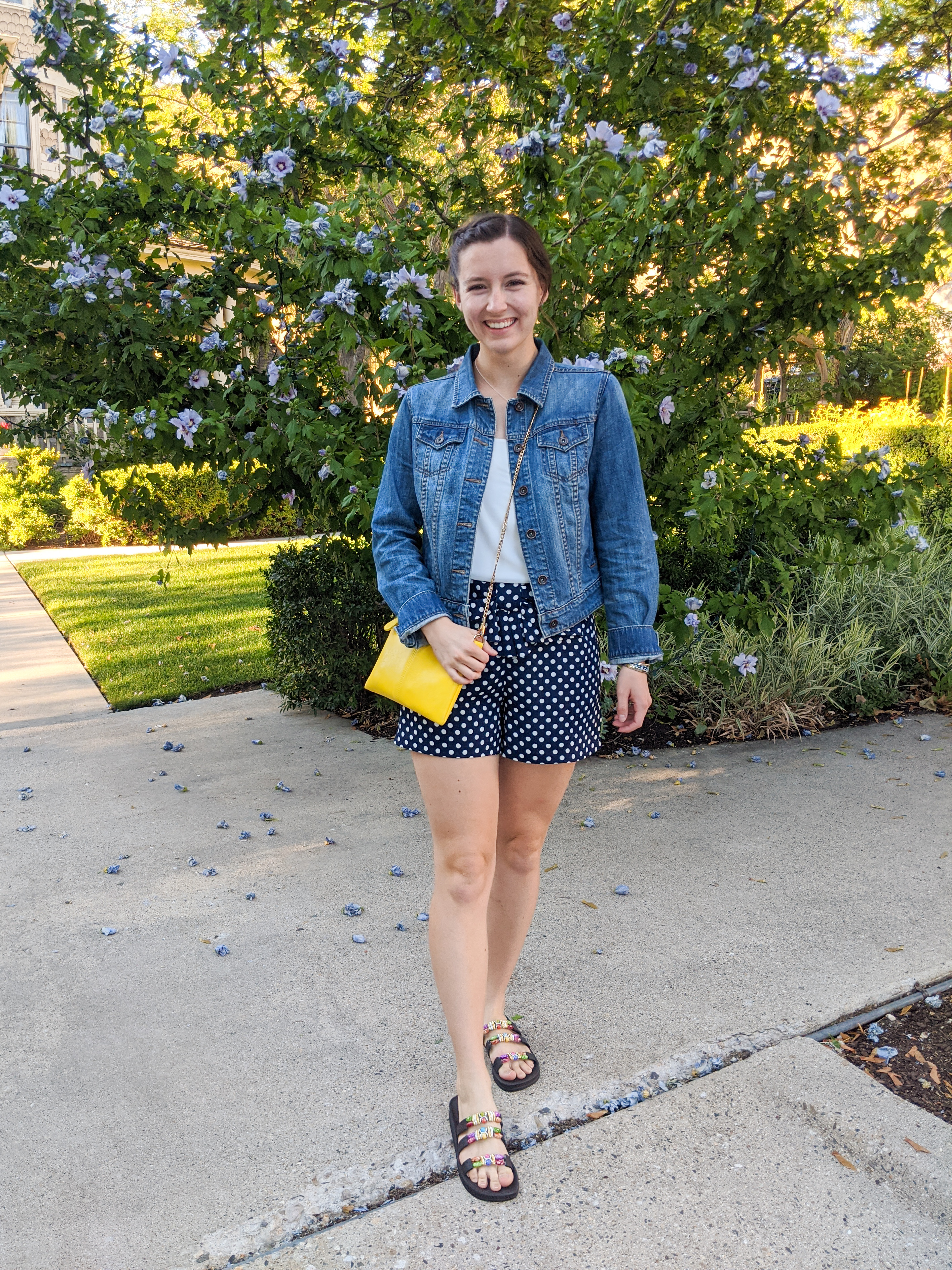 denim-jacket-yellow-purse-beaded-sandals
