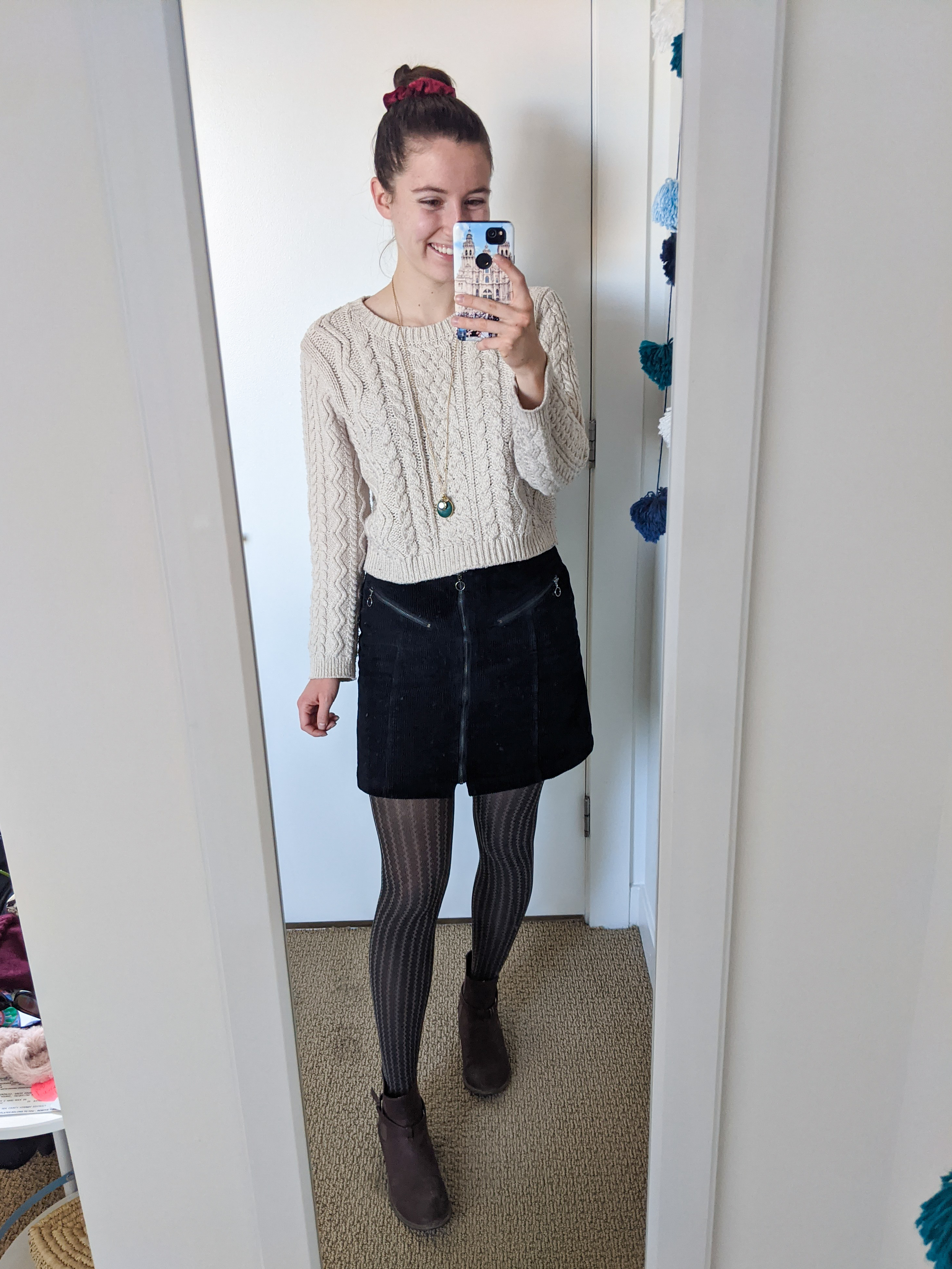 beige-sweater-cableknit-black-corduroy-skirt-patterned-tights