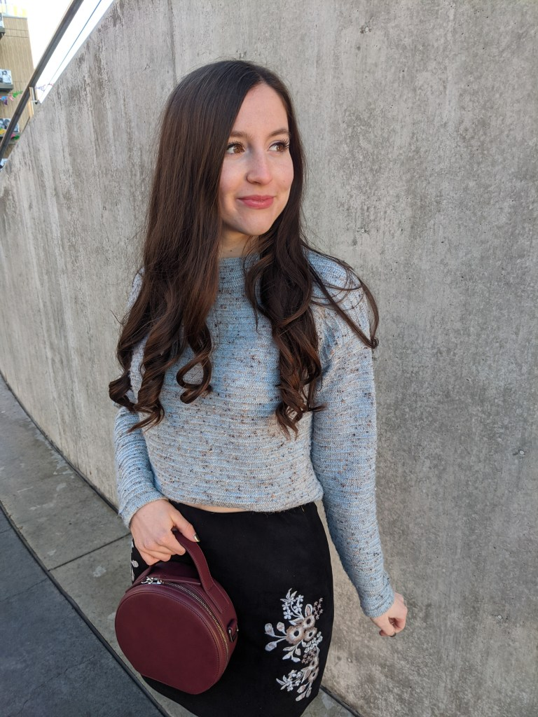 blue-sweater-maroon-purse-embroidered-skirt