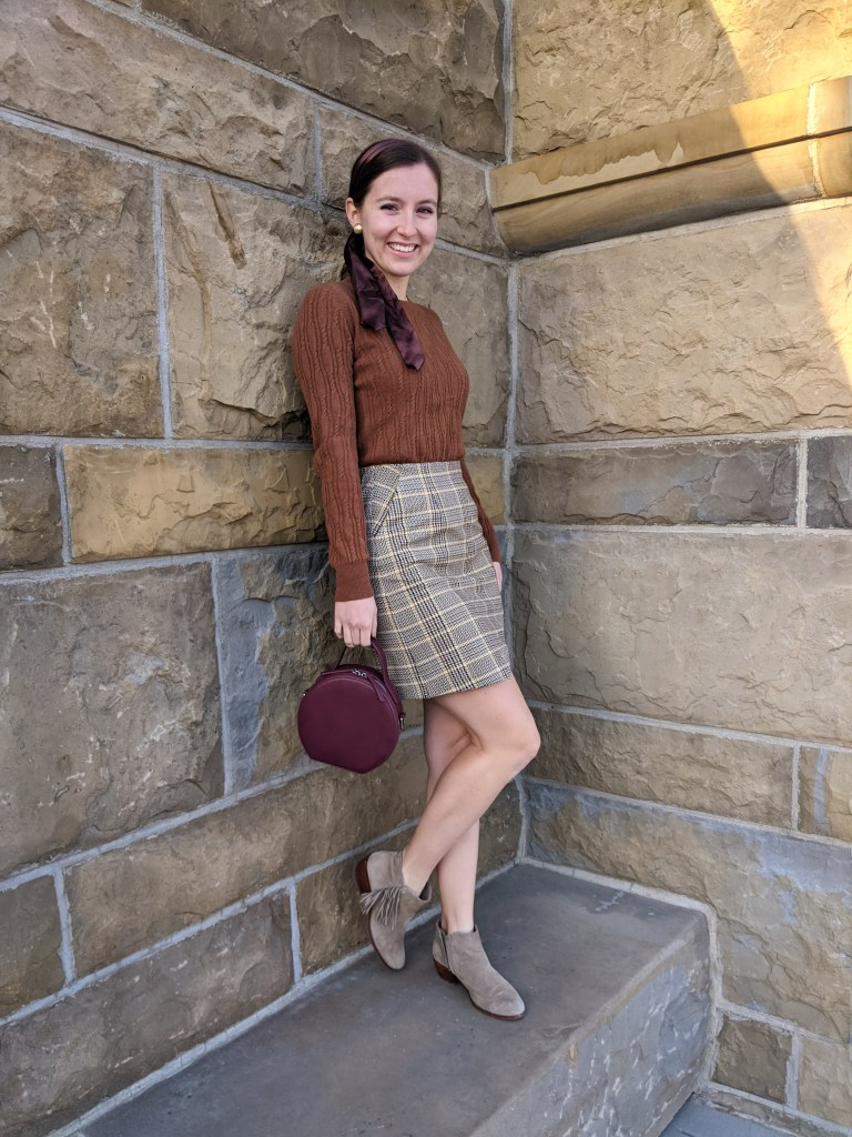plaid-skirt-brown-sweater-circle-purse