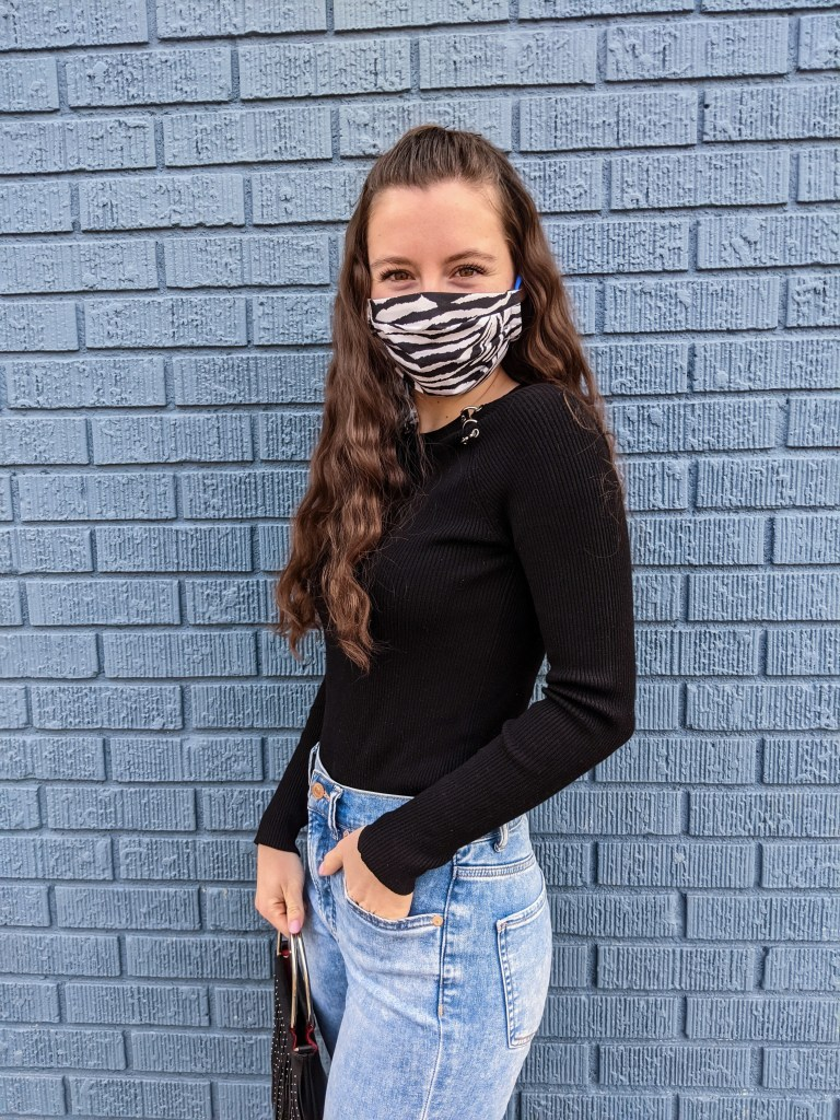 black-ribbed-sweater-zebra-facemask-mom-jeans