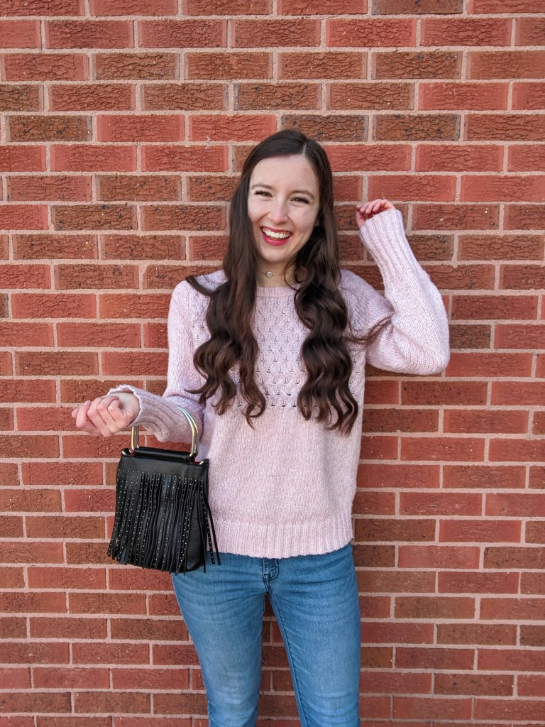 college-creator-linkup-curled-hair-pink-sweater