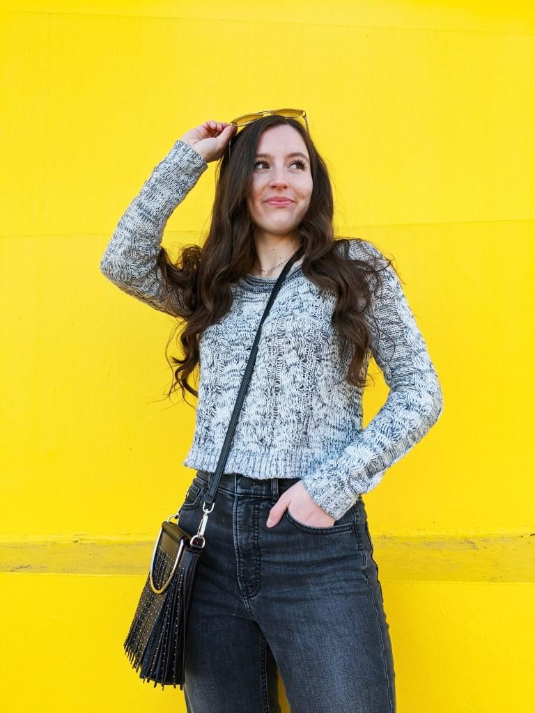 grey-sweater-express-jeans-black-crossbody-yellow-wall