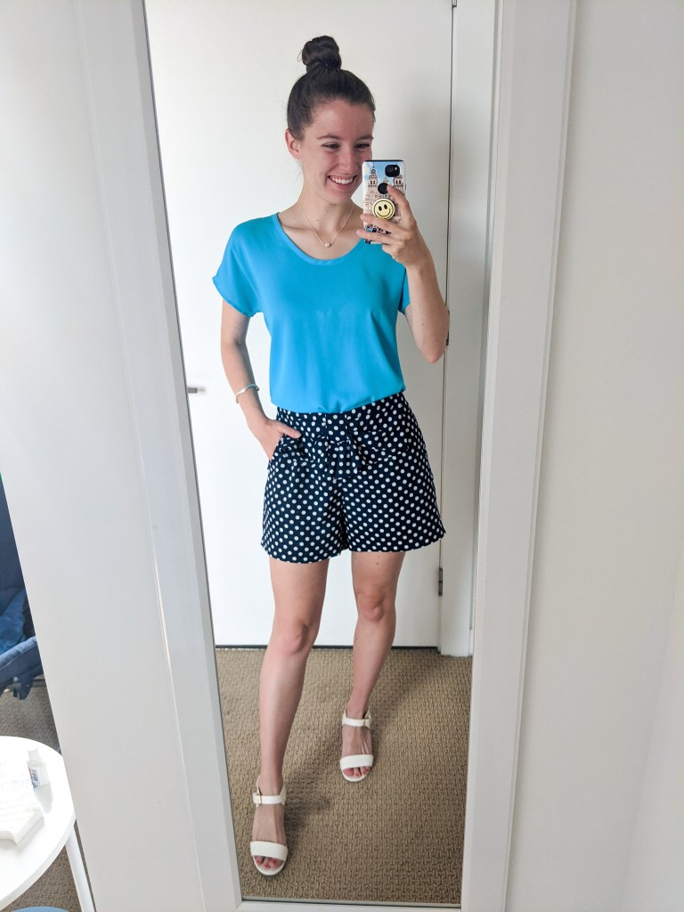 blue-blouse-polka-dot-shows-white-heels
