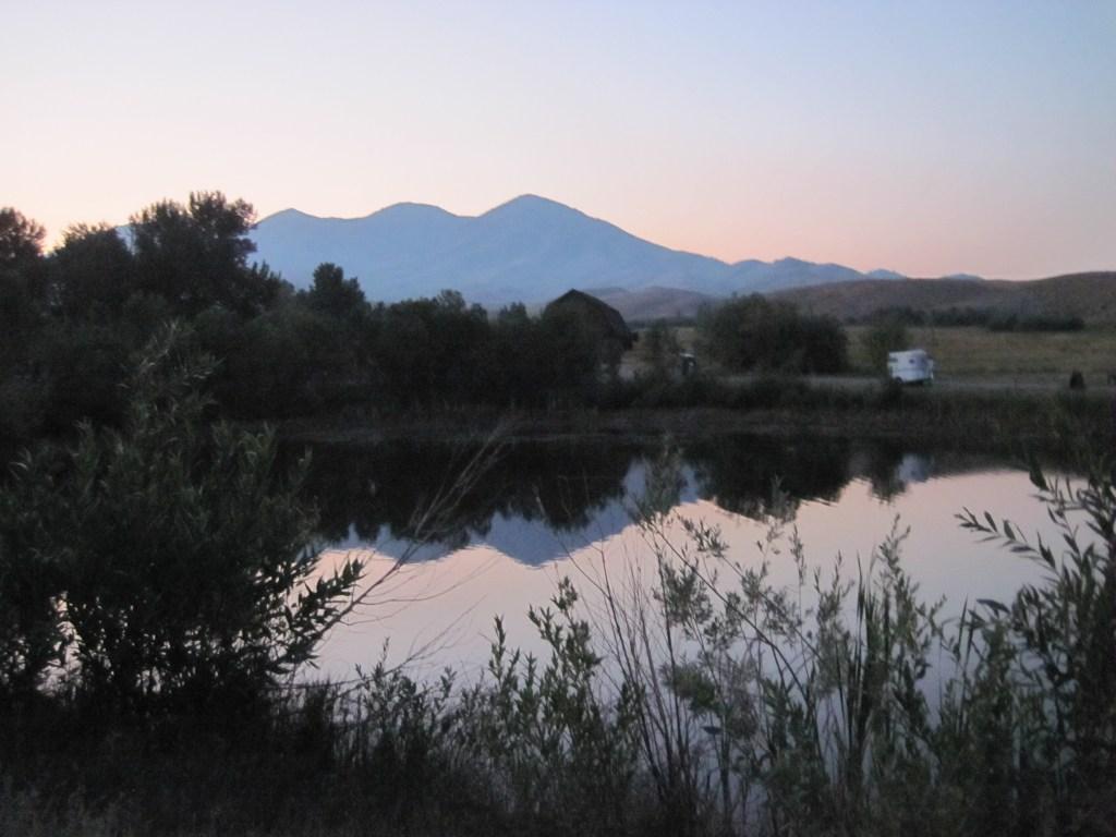 sunset-reflection-summer-camp-rainbow-gold