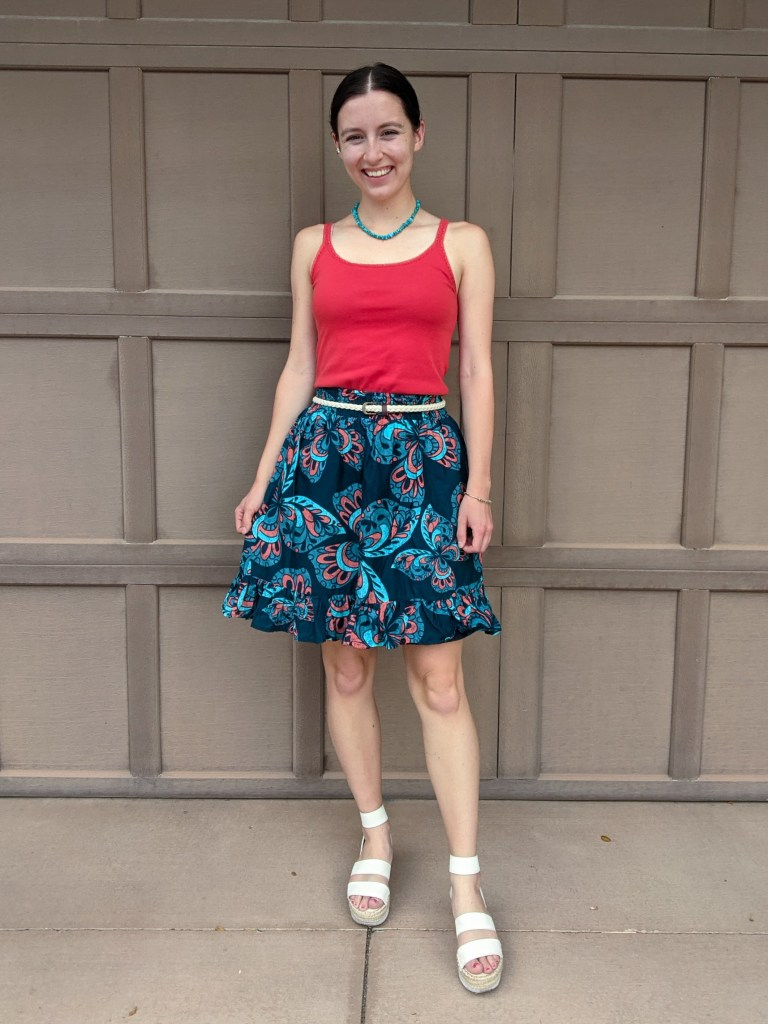 orange-top-navy-patterned-skirt-complementary-colors