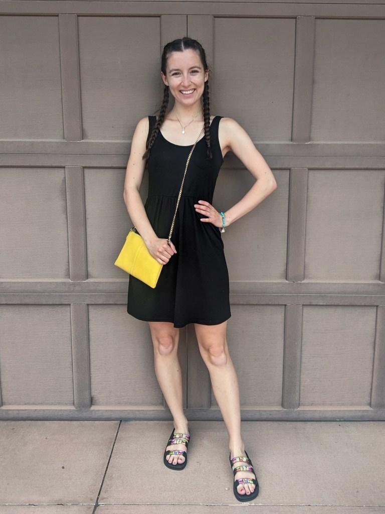 black-tank-dress-yellow-purse-beaded-sandals
