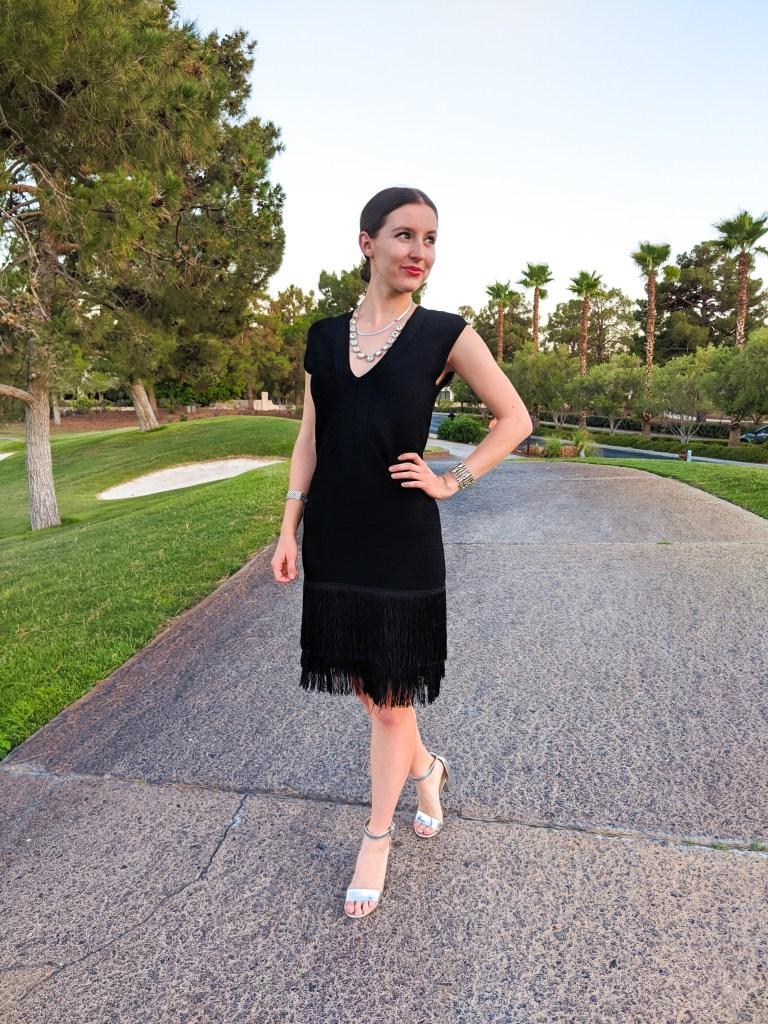 black-fringe-formfitting-dress-silver-block-heels-low-bun