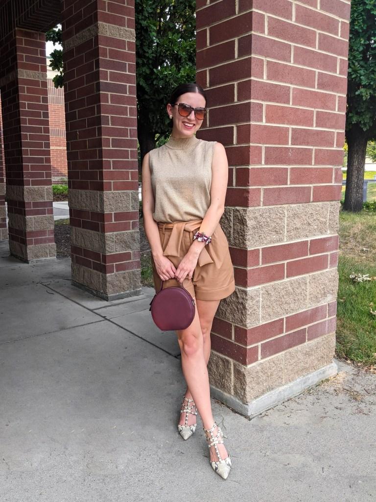 pleather-shorts-gold-mockneck-circle-purse