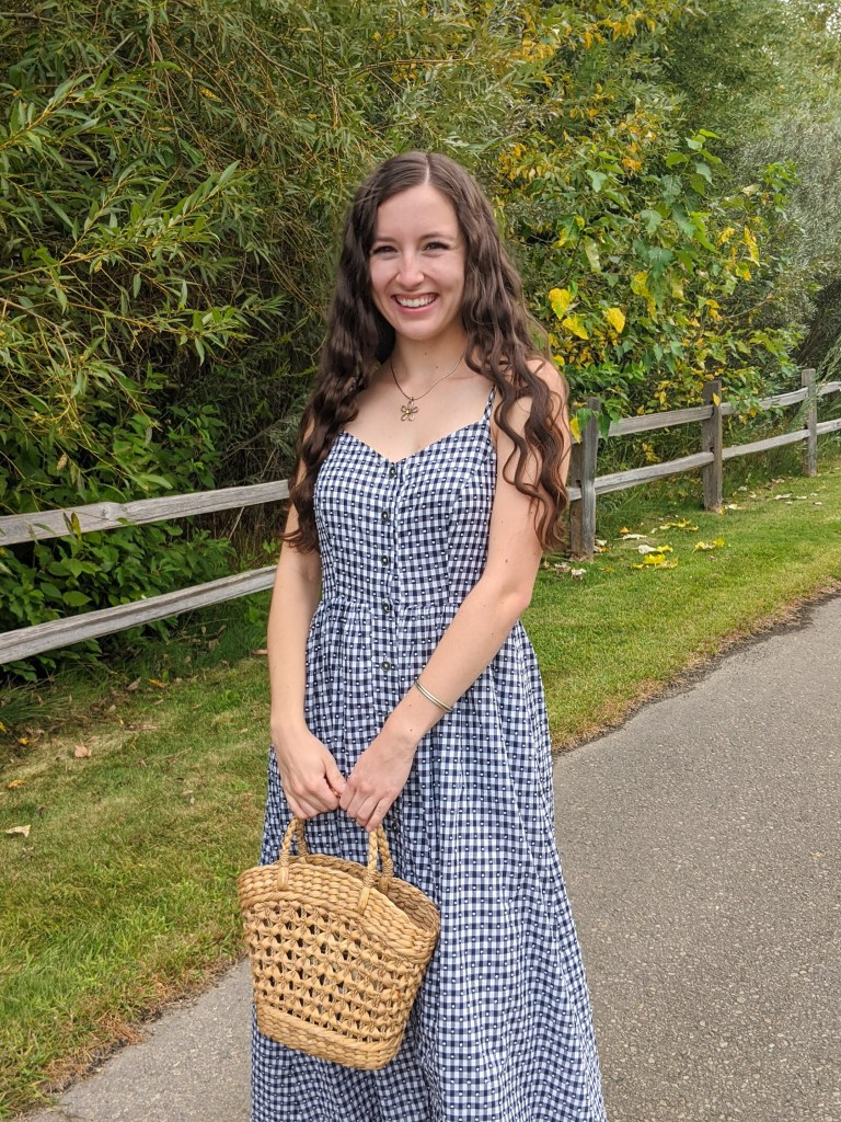 saucy-jewelry-gingham-dress-crimped-hair-straw-purse