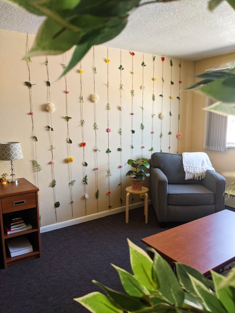 floral-garland-fake-plant-throw-blanket-college-apartment